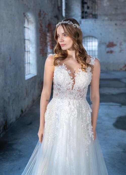 Hochzeitskleid im Prinzessstil mit Tüllrock und transparentem Spitzentop sowie Blütenapplikationen von Emine Yilidirim, Modell 9042