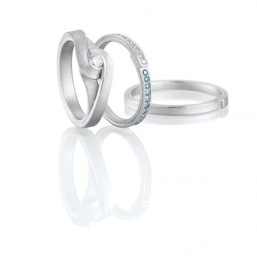 kreative Trauringe und Verlobungsring aus Platin mit Diamanten