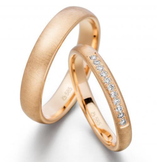 zierliche Trauringe aus Roségold mit Diamanten
